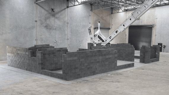 Представлен робот, способный построить дом из кирпича или блоков за 3 дня